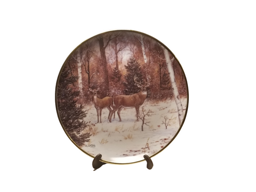 Collection Plate - In Winter Woods   A pair of Deer in a winter wood setting with snowfall.   Artist: Judi Whiting, Signed limited addition  Certificate of Authenticity by the International Wildlife Coalition, Designated an Heirloom by the Franklin Mint. Porcelain with 24K gold trim on rim and numbered