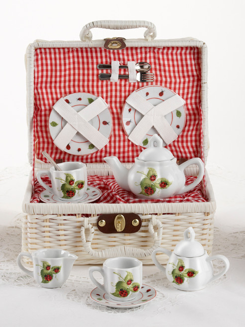 Toy Porcelain Tea Set in basket chest -Ladybug: It's a tea party set for two! Bright red Ladybug print tea set in a white picnic basket chest with red gingham check cloth liner. Perfect activity set for any little girl.  1-Teapot, 2-Cup and Saucer, 2-Serving plates, 2 each, Spoon and Fork, 1-Storage Picnic basket.  This set is part of the Cornucopia's Toy Tea party set and comes with additional add ons:  Perfect tea party compaion doll by Apple Dumplin Dolls 1 oz (12 tea parties or more) Children's Tea available There is hardly another fruit on this planet which is as popular among young and old as the strawberry. We are, therefore, presenting our particular, decaffeinated, flavored green tea variation. Its mild and, at the same time, intense taste is due to a natural strawberry flavoring, which shines when interacting with the soft tea basis. Ingredients: decaffeinated green tea, freeze-dried strawberry pieces, natural flavoring type strawberry. All choices are shipped together in one box. Gift card enclosure
