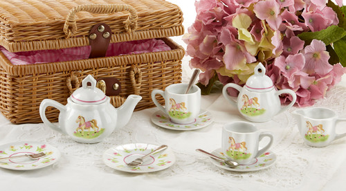 Toy Porcelain Tea Set in Basket- Pony: It's a tea party set for two! Little Pony print tea set in a natural picnic basket chest with matching cloth liner. Perfect activity set for any little girl.  1-Teapot, 2-Cup and Saucer, 2-Serving plates, 2 each, Spoon and Fork, 1-Storage Picnic basket.  This set is part of the Cornucopia's Toy Tea party set and comes with additional add ons:  Perfect tea party companion doll by Apple Dumplin Dolls 1 oz (12 tea parties or more) Children's Tea available There is hardly another fruit on this planet which is as popular among young and old as the strawberry. We are, therefore, presenting our particular, decaffeinated, flavored green tea variation. Its mild and, at the same time, intense taste is due to a natural strawberry flavoring, which shines when interacting with the soft tea basis. Ingredients: decaffeinated green tea, freeze-dried strawberry pieces, natural flavoring type strawberry. All choices are shipped together in one box. Gift card enclosure