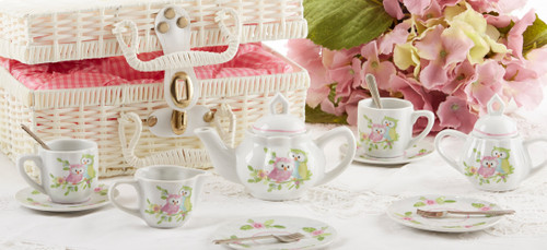 Toy Porcelain Tea Set in Basket- Owl: It's a tea party set for two!  Little Owl print tea set in a white picnic basket chest with pink check cloth liner. Perfect activity set for any little girl. Ages 5+  1-Teapot, 2-Cup and Saucer, 2-Serving plates, 2 each, Spoon and Fork, 1-Storage Picnic basket.  This set is part of the Cornucopia's Toy Tea party set and comes with additional add ons:  Perfect tea party companion doll by Apple Dumplin Dolls 1 oz (12 tea parties or more) Childrens Tea available There is hardly another fruit on this planet which is as popular among young and old as the strawberry. We are, therefore, presenting our particular, decaffeinated, flavored green tea variation. Its mild and, at the same time, intense taste is due to a natural strawberry flavoring, which shines when interacting with the soft tea basis. Ingredients: decaffeinated green tea, freeze-dried strawberry pieces, natural flavoring type strawberry. All choices are shipped together in one box. Gift card enclosure
