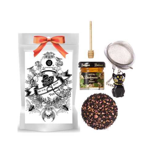 """Black Rose Tea (Loose Leaf) Black Cat Tea Ball gift set  Limited Edition by The Cornucopia's Tea Shop.Seasonal Halloween Label is a fun way to enjoy a traditional Black Assam Tea with rose petals and a Halloween Balck Cat Tea ball filter, more fun for the making. Set this Halloween Tea Package on your kitchen counter with it's Black Cat tea ball, for an added seasonal flair.  Gift includes:  2 oz. Black Rose Tea ( Loose Leaf ) 1- 2"""" Tea Ball with Black Cat, stainless steel Dickinson's Mini Honey Honey Spool  Cornucopia's Black Rose Tea combines our full-bodied organic black tea with fragrant rose petals.  Ingredients: Organic black tea, organic rose petals and natural flavor. Taste: Black Rose (Loose Leaf) is a full-bodied black tea brew with a floral finish.  Origin: Organic black tea is sourced from family tea gardens in the Darjeeling and Assam regions of India.  Gift comes in a cellophane gift bag with black raffia hand tied bow and gift card with brewing guide, 10% off next tea purchase, and your personalized gift message."""