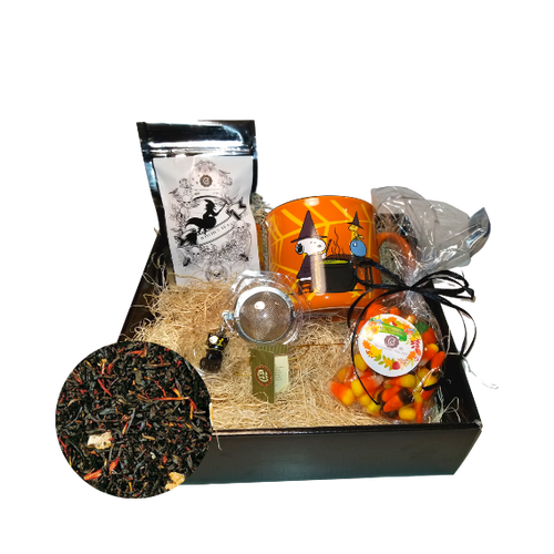 Halloween Mug Tea Gift Box - Woodstock Snoopy: This gift comes with seasonal Halloween mug, 1 oz. 12 cups of Cornucopia's Black Witch Tea limited edition with seasonal Halloween Label. A fun way to enjoy a traditional Black CeylonTea with blood orange peel and safflower, and a Halloween Black Cat Tea ball filter, and traditional bag of Candy Corn in reusable black gift box.  Gift Set Includes:  12 oz Mug Peanuts Woodstock Snoopy 1 oz 12 cups, Loose-Leaf Cornucopia Black Witch Tea (Loose Leaf)H8T22538 Cornucopia's Black Witch's Brew, a mild China-Ceylon black tea blend, will remind you just how Witchfully delightful it can be with light-yellow orange peel and orange-red blazing safflower. Ingredients: Black tea (92 %), orange peel, natural blood orange flavoring, safflower Taste: Wickedly tangy, fruity drink to take the chill out of a Halloween night. Origin: Organic black tea is sourced from family tea gardens in the Darjeeling and Assam regions of India. Cornucopia Teas come in resealable pouches with decorative tea labels as shown in the image. Halloween Black Cat Tea ball stainless steel Tea filter by Cha Cult (Germany) 1- 6.5 oz bag Cornucopia's Pumpkin mix Candy Corn with raffia bow  Gift enclosure card comes with a 10% off coupon for first time tea purchase for your recipient and your personal message. This enclosure cardis tucked inside the gift  Gift is shrink wrapped in black flat box with black raffia hand tied bow.