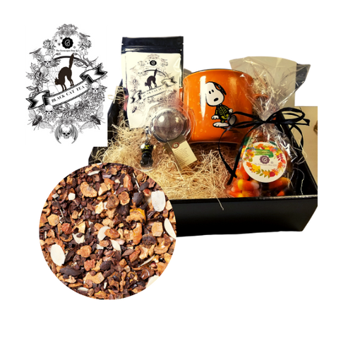 Halloween Mug Tea Gift Box - Snoopy Skeleton: This gift comes with seasonal Halloween mug, 1 oz. 12 cups of Cornucopia's Black Cat Tea limited edition with seasonal Halloween Label. A fun way to enjoy a traditional Black Assam Tea with rose petals and a Halloween Black Cat Tea ball filter, and traditional bag of Candy Corn in reusable black gift box.  Gift Set Includes:  12 oz Mug Snoopy Skeleton in traditional Halloween colors of orange and black 1 oz 12 cups, Loose-Leaf Cornucopia Black Cat Tea H8T21026 Cornucopia's Black Cat Halloween flavor is a darling of fortune! Sweet chocolate aromas, combined with delicately melting caramel and the taste of crunchy peanuts will put a smile on any sweet tooth! You think this is decadent? No, simply a lucky chance that no Black Cat could say! Ingredients:apple pieces, broken cocoa bits, cocoa peel, cream-caramel pieces (sweetened condensed skimmed milk, sugar, glucose, molasses, butter fat, wetting agent: sorbitol, emulsifying agent: mono- and diglyceride of edible fatty acids), flavoring, sliced almonds, planed almonds. Cornucopia Teas come in resealable pouches with decorative tea labels as shown in the image. Halloween Black Cat Tea ball stainless steel Tea filter by Cha Cult (Germany) 1- 6.5 oz bag Cornucopia's Pumpkin mix Candy Corn with raffia bow  Gift enclosure card comes with a 10% off coupon for first time tea purchase for your recipient and your personal message. This enclosure cardis tucked inside the gift  Gift is shrink wrapped in black flat box with black raffia hand tied bow.