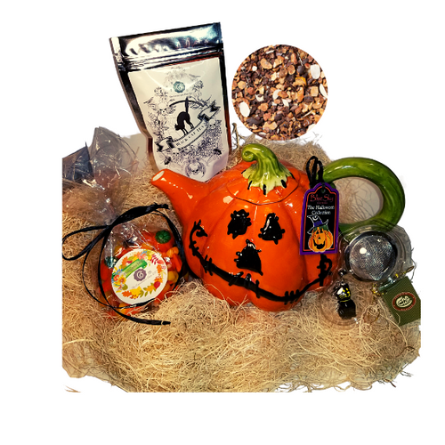 Halloween Pumpkin Teapot Gift Box :  This gift comes with seasonal Halloween Teapot, 1 oz. 12 cups of Cornucopia's Black Cat Tea limited edition with seasonal Halloween Label. A fun way to enjoy a traditional Black Assam Tea with rose petals and a Halloween Black Cat Tea ball filter, and traditional bag of Candy Corn in reusable black gift box.   Gift Set Includes:  4 cup Pumpkin Ceramic Teapot in traditional Halloween colors of orange and black 1 oz 12 cups, Loose-Leaf Cornucopia Black Cat Tea H8T21026 Cornucopia's Black Cat Halloween flavor is a darling of fortune! Sweet chocolate aromas, combined with delicately melting caramel and the taste of crunchy peanuts will put a smile on any sweet tooth! You think this is decadent? No, simply a lucky chance that no Black Cat could say! Ingredients:apple pieces, broken cocoa bits, cocoa peel, cream-caramel pieces (sweetened condensed skimmed milk, sugar, glucose, molasses, butter fat, wetting agent: sorbitol, emulsifying agent: mono- and diglyceride of edible fatty acids), flavoring, sliced almonds, planed almonds. Cornucopia Teas come in resealable pouches with decorative tea labels as shown in the image. Halloween Black Cat Tea ball stainless steel Tea filter by Cha Cult (Germany)  1- 6.5 oz bag Cornucopia's Pumpkin mix Candy Corn with raffia bow  Gift enclosure card comes with a 10% off coupon for first time tea purchase for your recipient and your personal message. This enclosure card is tucked inside the gift  Gift is shrink wrapped in black flat box with black raffia hand tied bow.