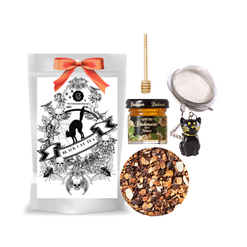 """Black Cat Tea (Loose Leaf) Black Cat Tea Ball gift set  Limited Edition by The Cornucopia's Tea Shop. Seasonal Halloween Label is a fun way to enjoy a fruit blend dessert tea without the guilt, and a Halloween Black Cat Tea ball filter, adds more fun for the making. Set this Halloween Tea Package on your kitchen counter with it's Black Cat tea ball, for an added seasonal flair.  Gift includes:  2 oz. Black Cat Tea ( Loose Leaf ) 1- 2"""" Tea Ball with Black Cat, stainless steel Dickinson's Mini Honey Honey Spool  Cornucopia's Black Cat Fruit tea blend flavored Chocolate Peanut Caramel. No trick here, the sweet chocolate aromas, combined with delicately melting caramel and the taste of crunchy peanuts will put a smile on any sweet tooth!  Ingredients: apple pieces, broken cocoa bits, cocoa peel, cream-caramel pieces (sweetened condensed skimmed milk, sugar, glucose, molasses, butter fat, wetting agent: sorbitol, emulsifying agent: mono- and diglyceride of edible fatty acids), flavoring, sliced almonds, planed almonds. Taste: Halloween's best chocolate trick or treat candy bar without the guilt! This dessert tea can be enjoyed year round.  Origin: Organic black tea is sourced from family tea gardens in the Darjeeling and Assam regions of India.  Gift comes in a cellophane gift bag with black raffia hand tied bow and gift card with brewing guide, 10% off next tea purchase, and your personalized gift message."""