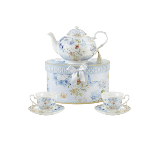 """Blue Butterfly Tea set, will brighten anyone's day with this beautiful tea set in its own matching print gift box with matching satin ribbon. A decorative tassel on the handle adds a lovely finishing touch. Gifting Idea: birthday gift, bridal shower, get well, treat yourself or someone you love.  Includes:  9.5 x 5.6"""" teapot, Porcelain holds 4 cups (32 oz) 2 cup/saucer Soft white background with a Blue Butterfly and pastel floral print Dishwasher safe  Other Items Available:  additional Matching cup and saucer available D8151-4  Tea choices available to add to your order in the loose-leaf shop  Teas and Teaware are shipped together, Cornucopia Teas come in resealable pouches with decorative tea labels, and includes a recipe and brewing guide. If purchasing as a gift your personal message is included on the pamphlet."""