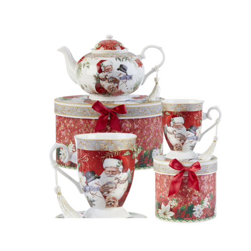 """Santa Tea set,a beautiful Christmas tea set in its own matching print gift box with coordinating satin ribbon. A decorative tassel on the handle adds a lovely finishing touch. To be enjoyed throughout the holiday season, makes a lovely gift for that special tea drinker on your gift list! Add one of Cornucopia's Loose Leaf Christmas Tea blends to finnish off this special holiday gift.  Includes:  9.5 x 5.6"""" teapot 2 Mugs Soft white with a Christmas floral print background with Santa and his friends Dishwasher safe  Choose a Christmas Tea by the Cornucopia Shop  These specialty loose leaf teas are Christmas holiday blends that are seasonal favorties in herbals and black tea base with christmas spice blends, marshmallow, pear, organge and chocolate. Robust flavors, chuncky fruites and chocolate pieces to endulge and enjoy this holiday season.  Teas and Teaware are shipped together, Cornucopia Teas come in resealable pouches with decorative tea labels, and includes a recipe and brewing guide. If purchasing as a gift your personal message is included on the pamphlet.  Enclosed Gift Card Sample - Standard Cover and coupon with your personalized gift message. 200 characters max."""
