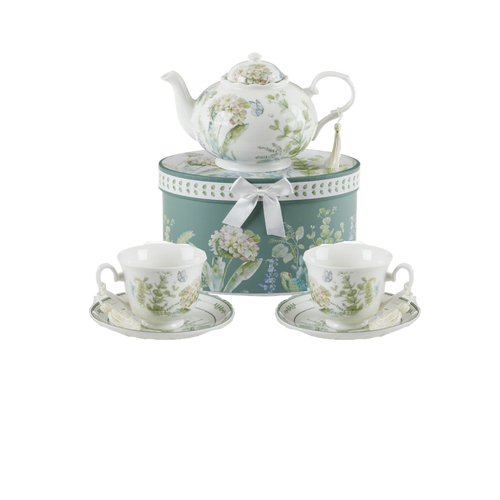 """Blue Hydrangea Tea Set, will brighten anyone's day with this beautiful tea set gift in its own matching print gift box with matching satin ribbon. A decorative tassel on the handle adds a lovely finishing touch. Gifting Idea: birthday gift, bridal shower, get well, treat yourself or someone you love.  Includes:  9.5 x 5.6"""" teapot, Porcelain, holds 4 cups (32 oz) 2 cup/saucer Soft white background with a Blue Hydrangea and pastel floral print Dishwasher safe  Other Items Available:  Add additional sets of matching cup and saucer D8151-4  Tea choices available to add to your order in the loose-leaf shop  Teas and Teaware are shipped together, Cornucopia Teas come in resealable pouches with decorative tea labels, and includes a recipe and brewing guide. If purchasing as a gift your personal message is included on the pamphlet."""