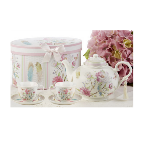 """Feather and Floral Tea Set, will brighten anyone's day with this beautiful tea set in its own matching print gift box and matching satin ribbon. A decorative tassel on the handle adds a lovely finishing touch. Gifting Ideas: birthday gift, bridal shower, get well, treat yourself or someone you love.  Includes:  9.5 x 5.6"""" Porcelain teapot 2 cup/saucer Soft white background with a feather and floral print in bright cheery pastels, Dishwasher safe  Other Items Available:  Add additional sets of matching cup and saucer D8135-6 Tea choices available to add to your order in the loose-leaf shop Teas and Teaware are shipped together, Cornucopia Teas come in resealable pouches with decorative tea labels, and includes a recipe and brewing guide. If purchasing as a gift your personal message is included on the pamphlet."""