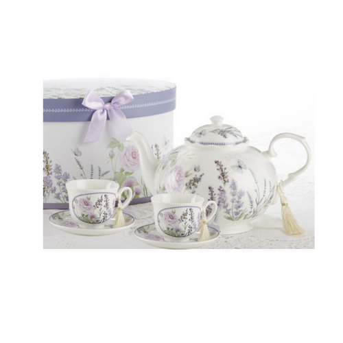 """Lavender Fields Tea Set, will brighten anyone's day with this beautiful tea set gift in its own lavender flower print gift box with matching satin ribbon. A decorative tassel on the handle adds a lovely finishing touch. Gifting Idea: birthday gift, bridal shower, get well, treat yourself or someone you love.  Includes:  9.5 x 5.6"""" Porcelain teapot 2 cup/saucer Soft white background with lavender floral print Dishwasher safe  Other Items Available:  Add additional sets of matching cup and saucer D8101-7  Tea choices available to add to your order in the loose-leaf shop  Teas and Teaware are shipped together, Cornucopia Teas come in resealable pouches with decorative tea labels, and includes a recipe and brewing guide. If purchasing as a gift your personal message is included on the pamphlet."""