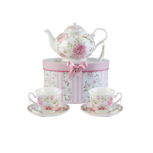 """Pink Peony Tea Set, will brighten anyone's day with this beautiful tea set in its own matching print gift box with matching satin ribbon. A decorative tassel on the handle adds a lovely finishing touch. Gifting Idea: birthday gift, bridal shower, get well, treat yourself or someone you love.  Includes:  9.5 x 5.6"""" teapot 2 cup/saucer Soft white background with a Pink Peony floral print Dishwasher safe  Tea choices available to add to your order in the loose-leaf shop  Teas and Teaware are shipped together, Cornucopia Teas come in resealable pouches with decorative tea labels, and includes a recipe and brewing guide. If purchasing as a gift your personal message is included on the pamphlet."""