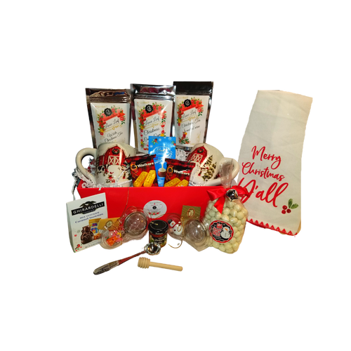 """Merry Christmas Y'all - Christmas Gift Basket, a beautiful Christmas for Two. Filled with gourmet food items, two country winter mugs, tea accessories and seasonal tea towels. This gift comes with an assortment of gourmet cookies, candies, teas, honey and 7 gifts that will last long after the goodies are gone along with the reusable gift tray. Cornucopia's gourmet teas are sourced from the finest tea plantations from around the world. This high-quality gourmet gift basket and tea gifts is a Cornucopia exclusive that you can be proud to send.   Includes:  2 Ceramic countryside Christmas mug Dishwasher/Microwave safe Snowy farm scene with snowman 3 - 1 oz. Cornucopia Christmas Teas Candy Cane Ingredients: apple pieces, pineapple cubes (pineapple, sugar), natural flavoring, marshmallows (glucose-fructose syrup, sugar, water, gelatin, corn starch, natural flavoring), whole star aniseed, freeze-dried whole red currants, peppermint, pink cornflower blossoms. Mulled Wine ingredients: apple pieces, hibiscus blossoms, elderberries, rose hip peel, Mistletoe, cinnamon rods, flavoring celery seed oil, orange slices, cloves. White Christmas ingredients: Green tea (50 %), cocoa peel, ginger cubes (sugar, ginger, acidifying agent: citric acid), pear pieces, ginger pieces, flavoring, freeze-dried pear pieces 1 Snowman Tea Ball, Stainless Steel 1 1/2"""" made in Germany Cha Cult 1 Angel Tea Ball, Stainless Steel 1 1/2"""" made in Germany Cha Cult 1 Mini Bonne Maman Honey 1 Honey Spool 1 White tea towel with screen printed """"Merry Christmas Y'all"""" message with holy berry accents and embroidered trim 1.4 oz. Walker Shortbread Cookie .8 oz. Lindt Lindor Snowmen Milk Chocolate Truffles .7 oz. Ghirardelli Milk Chocolate Caramel Snowmen .9 oz. Long Grove Snowball pretzels  Gift comes in a keepsake Red handled tray, white shred and shrink wrapped with white bow. Gift Enclosure Card is placed inside the gift with your personal message and 10% off tea discount coupon."""