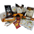 """Harvest Gourmet Delights Gift Basket: From Cornucopia's Epicure Shop, a showcase of gourmet specialties brimming in fall flavors with pumpkin and apple dessert dips, sunflower crackers, popping corn cob, caramel dip, and dipping pretzels. An array of shelf-stable, cheeses, Summer Sausage, Gourmet Crackers, Mixed Nuts, (by Jocelyn & Co) & (The Cornucopia Shop) all tucked inside this beautiful dark stained wicker basket with drop down handles your recipient can use to decorate their fall table.    Gift Includes:  5"""" dark stained willow basket with drop handles Mini Cheese Spreader, Stainless Steel Cleaver, 2 oz East Shore Dipping Pretzel East Shore Caramel Dipping Sauce 1 oz. Sunflower Organic Sea Salt Cracker, *5 oz Hardwood Smoked Summer Sausage, *8 oz Cheddar Cheese bar 7"""" tall x ¾ """"thick, Garlic & Cheese Dip/Spread by Lambs of Thyme, our favorite gourmet spice company Popping Corn Cob, Outrageous Apple Dip Outrageous Pumpkin Dip 2 Be-Bop Hazelnut Zebra Biscotti 4 oz Walker's Fingers Shortbread Cookie -2 pack 1 oz Pumpkin Pie Fruit Tea (Loose Leaf) Ingredients: pumpkin cubes, apple pieces, cinnamon pieces, ginger cubes (sugar, ginger, acidifying agent: citric acid), turmeric roots, cinnamon rods, cloves, cardamom (whole), pink pepper, natural flavoring. 1 oz. Autumn Apple Cider Fruit Tea (Loose Leaf) Ingredients: apple pieces, cinnamon rods, hibiscus blossoms, apple slices, sliced almonds, rose hip peel, elderberries, currants, whole star aniseed, natural flavoring, cinnamon pieces. 2"""" Tea Ball with fall flower charm, stainless steel Dickinson's Mini Honey 1 oz. Honey Spool wooden Cornucopia's Pumpkin Spice Scone Mix, makes 8 scones  *Gourmet Food products are made in the USA and are shelf stable.  Gift comes wrapped in cellophane with hand tied plaid bow, a complimentary enclosure card with your personal message"""