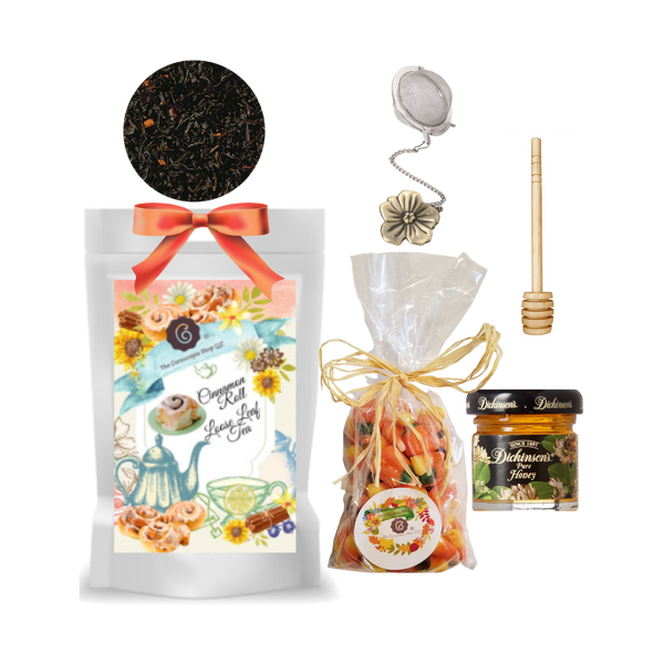 """Harvest Tea Gift Basket-Cinnamon Roll  Limited Edition by The Cornucopia's Tea Shop. Seasonal Label is a fun way to enjoy a fall tea favorite, with everything needed to make a loose leaf brew. A sip of tea and a nibble of candy just what the day ordered!  Gift includes:  1 oz. Cinnamon Roll Black Tea (Loose Leaf) The strong China Ceylon blend, enriched with crushed cinnamon pieces from Ceylon receives its perfectly balanced taste through our expressive cinnamon flavor. Quite simple and perfect.Ingredients: black tea (90 %), cinnamon pieces, flavoring. 1- 2"""" Tea Ball with fall flower charm, stainless steel, Dickinson's Mini Honey 1 oz. Honey Spool wooden,7 oz Autumn Pumpkin mix Candy Corn with chocolate candy corn, original candy corn and pumpkins, gift pack with natural rafia hand tied bow.  Gift comes in a shrink wrapped tray with natural raffia hand tied bow and gift card with brewing guide, 10% off next tea purchase, and your personalized gift message."""