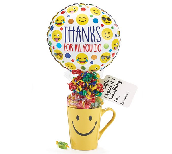 """Thanks For All You Do Smiley Mug Bouquet  Perfect for anyone you'd like to show your appreciation for all they have done.  Includes stoneware Smiley mug, 9"""" air-filled Thanks for all you do! balloon, a mix of name brand candy such as Starburst, SweetTarts, Tootsie Roll, Jolly Rancher, Skittles, Nerds, LaffyTaffy or Tootsie Fruit Chews. Mix may vary in each gift. ribbon curls, cellophane wrap, and card. ribbon curls, cellophane, and card.  For large orders please contact us."""