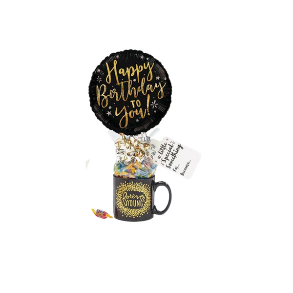 """Forever Young Candy Mug Balloon Bouquet  Over the hill, NOT! the forever young mug surely will make them feel their counting birthdays backward going forward. Send this fun gift for those growing a little older this birthday.  Includes ceramic black with gold forever young print mug, Black Happy Birthday 9"""" air-filled balloon, a mix of name brand candy such as Starburst, SweetTarts, Tootsie Roll, Jolly Rancher, Skittles, Nerds, LaffyTaffy or Tootsie Fruit Chews. Mix may vary in each gift. ribbon curls, cellophane wrap, and card. ribbon curls, cellophane, and card."""