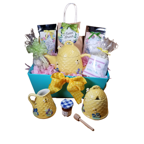 Easter Gift Basket Tray - Beehive Tea Set: 3pc tea set, Charming beehive pattern with bizzy bees. matching cream and sugar bowl. Bright and cheerful gift set, sure to bring a smile to their face. This gift basket tray is filled with gourmet tea related treates in a pastel spring themed giftwrap. Shrink wrapped and homemade bow. The tray can be used for storage, made of heavy carboard construction.  A complimentary matching gift enclosure card with your personal message.  Includes a 10% off their first purchase of loose leaf tea with us.       Includes:  3 pc set - 2 cup teapot, sugar bowl and creamer. Bright yellow beehive pattern with 3D bizzy bees on lids and sides of pot with rasied decorative pattern.  Handwash 1 oz Earl Grey Cream loose leaf tea  Easter Brunch Lemon Scone Mix J & M spiced tea cookie Easter Bunny Cotton Tails - Candy coated pretzel bites Mini honey  Honey spool   Delivered in decorative basket tray, shrink wrapped with coordinating decorative bow.  A personalized Easter themed gift card, tucked inside the git.