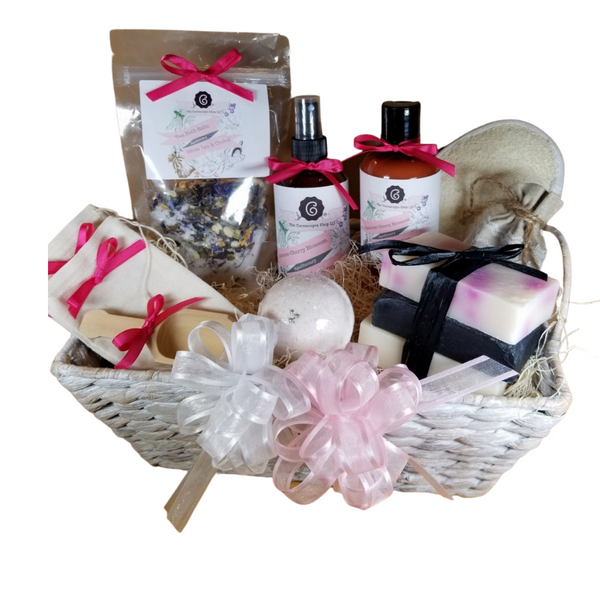 """White Tea & Orchid – Luxury Spa Gift Basket by The Cornucopia Shop LLC: Our Bath Soaks are made of the highest quality ingredients of botanicals, Teas, Essential Oils, Dead Sea Bath Salts, Epsom Bath Salts, & Pink Himalayan Salts. Aromatherapy to lift and rejuvenate the mind. Our line includes Hand Crafted Cold Process Soaps, Body Lotions and Perfume Body Sprays, and Luxury Bath Bombs to sooth, soften and re-fresh. Dried Botanical Lingerie Sachet to scent a drawer.   Includes:  1- 4 oz White Tea & Orchid Bath Salts all-natural no dyes, 1- 8 oz Japanese Cherry Blossom Body Lotion 1- 8 oz Japanese Cherry Blossom Body Spray 1-.05 oz Super Lavender Drawer Sachet 2- Linen Bath Tea Bags(re-usable) hand wash 1- Wooden Bath Salt Scoop 1- Loofah & Terry Cloth reversible Wash Pad with Wrist Band 5 oz 2 1/2 """", Vanilla Carmael with jewel top Bath Bomb 3 Cold Process Bar Soaps, Japanese Tea Blossom, White Tea & Ginger Black Soap with activated charcoal  Gift comes shrink wrapped in reusable whitewashed natural fiber basket with handles, natural fiber fill, decorative gift bow, and enclosure gift card.  Key Ingredients:Bath Salt: Organic White Tea & Orchid loose leaf tea, Epsom Salts, White Tea and Orchid Essentail Oil. Organic Jasmine flowers, Blue Corn Flowers. Body lotion:Water, Blend of (Coconut Oil, Hempseed Oil, Sunflower Oil, Vitamin E, Mineral Oil), Propylene Glycol, Stearic Acid, Cetyl Alcohol, Phenoxyethanol, Ethylhexylglycerin, Glyceryl Stearate, Petrolatum, TEA 99%, Proprietary Fragrance and Essential Oil Blend, Dimethicone, Carbopol, Disodium EDTA, Allantoin, Aloe Vera Gel.Perfume Body Spray:Water, Ploysorbate 20, Fragrance,,DMDM Hydntoin, Disodium EDTACold Process Soaps:Olive Oil, Soybean Oil, Coconut Oil, Corn Oil. Sunflower Oil, Organic Shea Butter, Water. Sodium Hydroxide (Lye), Fragrance INCI: Olea Europaea (Olive) Oil, Glycine Soja (Soybean) Oil, Cocos Nucifera (Coconut) Oil, Zea Mays (Corn) Oil, Helianthus Annuus (Sunflower) Seed Oil, Butyrospermum Parkii (She"""