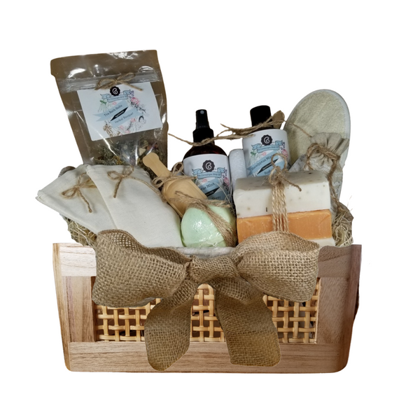 """Eucalyptus Bahama Spa - Gift Basket by The Cornucopia Shop LLC: Our Bath Soaks are made of the highest quality ingredients of botanicals, Teas, Essential Oils, Dead Sea Bath Salts, Epsom Bath Salts, & Pink Himalayan Salts. Aromatherapy to lift and rejuvenate the mind. Our line includes Hand Crafted Cold Process Soaps, Body Lotions and Perfume Body Sprays, and Luxury Bath Bombs to sooth, soften and re-fresh. Dried Botanical Lingerie Sachet to scent a drawer.   Includes:  Tommy Bahama with Rope Handles Basket 1- 4 oz Herbal Bath Salts all-natural no dyes, 1- 8 oz Eucalyptus Mint Body Lotion 1- 8 oz Eucalyptus Mint Body Spray 1-.05 oz Super Lavender Drawer Sachet 2- Linen Bath Tea Bags(re-usable) hand wash 1- Wooden Bath Salt Scoop 1- Loofah & Terry Cloth reversible Wash Pad with Wrist Band 5 oz 2 1/2 """", Breath Easy Eucalyptus Bath Bomb 3 Cold Process Bar Soaps, Eucalyptus Aloe Apricot Chamomile Bamboo Mud  Gift comes shrink wrapped in reusable Tommy Bahama with Rope Handles Basket, natural fiber fill, decorative gift bow, and enclosure gift card.  Key Ingredients:Bath Salt: Organic herbal bath mix, Epsom Salts Body lotion: Water, Blend of (Coconut Oil, Hempseed Oil, Sunflower Oil, Vitamin E, Mineral Oil), Propylene Glycol, Stearic Acid, Cetyl Alcohol, Phenoxyethanol, Ethylhexylglycerin, Glyceryl Stearate, Petrolatum, TEA 99%, Proprietary Fragrance and Essential Oil Blend, Dimethicone, Carbopol, Disodium EDTA, Allantoin, Aloe Vera Gel. Perfume Body Spray:Water, Ploysorbate 20, Fragrance,,DMDM Hydntoin, Disodium EDTA Cold Process Soaps:Olive Oil, Soybean Oil, Coconut Oil, Corn Oil. Sunflower Oil, Organic Shea Butter, Water. Sodium Hydroxide (Lye), Fragrance INCI: Olea Europaea (Olive) Oil, Glycine Soja (Soybean) Oil, Cocos Nucifera (Coconut) Oil, Zea Mays (Corn) Oil, Helianthus Annuus (Sunflower) Seed Oil, Butyrospermum Parkii (Shea Butter), Aqua, Sodium Hydroxide, Fragrance. May contain charcoal, FD&C color. Please note, that due to the handmade nature of this soap, co"""