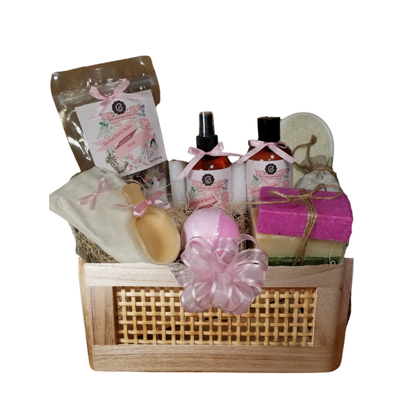 """Rose Garden Bahama Spa - Gift Basket, by The Cornucopia Shop LLC: Our Bath Soaks are made of the highest quality ingredients of botanicals, Teas, Essential Oils, Dead Sea Bath Salts, Epsom Bath Salts, & Pink Himalayan Salts. Aromatherapy to lift and rejuvenate the mind. Our line includes Hand Crafted Cold Process Soaps, Body Lotions and Perfume Body Sprays, and Luxury Bath Bombs to sooth, soften and re-fresh. Dried Botanical Lingerie Sachet to scent a drawer.   Includes:  Tommy Bahama basket with rope handles 1- 4 oz Rose Bath Salts all-natural no dyes Super Rose origin Egypt 1- 8 oz Rose Milk & Honey Body Lotion 1- 8 oz Rose Milk & Honey Body Spray 1-.05 oz Super Lavender Drawer Sachet 2- Linen Bath Tea Bags(re-usable) hand wash 1- Wooden Bath Salt Scoop 1- Loofah & Terry Cloth reversible Wash Pad with Wrist Band 5 oz 2 1/2 """", Sugar Rose Bath Bomb 3 Cold Process Bar Soaps, English Garden Rocky Rose Moonlight & Roses Scrub  Gift comes shrink wrapped in reusable Tommy Bahama basket with rope handles, natural fiber fill, decorative gift bow, and enclosure gift card.  Key Ingredients:Bath Salt: Super Egyptian Rose Buds and petals, Epsom Salts, Rose Flower Essentail Oil.Body lotion:Water, Blend of (Coconut Oil, Hempseed Oil, Sunflower Oil, Vitamin E, Mineral Oil), Propylene Glycol, Stearic Acid, Cetyl Alcohol, Phenoxyethanol, Ethylhexylglycerin, Glyceryl Stearate, Petrolatum, TEA 99%, Proprietary Fragrance and Essential Oil Blend, Dimethicone, Carbopol, Disodium EDTA, Allantoin, Aloe Vera Gel.Perfume Body Spray:Water, Ploysorbate 20, Fragrance,,DMDM Hydntoin, Disodium EDTACold Process Soaps:Olive Oil, Soybean Oil, Coconut Oil, Corn Oil. Sunflower Oil, Organic Shea Butter, Water. Sodium Hydroxide (Lye), Fragrance INCI: Olea Europaea (Olive) Oil, Glycine Soja (Soybean) Oil, Cocos Nucifera (Coconut) Oil, Zea Mays (Corn) Oil, Helianthus Annuus (Sunflower) Seed Oil, Butyrospermum Parkii (Shea Butter), Aqua, Sodium Hydroxide, Fragrance. May contain charcoal, FD&C color. Pleas"""
