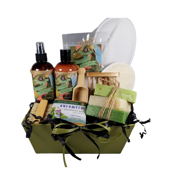 Men's Green Tea & Citrus Spa - Gift Basket Tray by The Cornucopia Shop LLC:  a luxury spa gift just for him.  Our line includes Hand Crafted Cold Process Soaps in complimentary scents, Body Quenchers to soften skin, and Body Refresher Sprays, to use anytime for a cooling mist with a light scent he'll love. 8 ounces of foot soak to ease, sooth and refresh tired feet. Can also be used in the tub for an overall body rejuvenation.  This gift also includes a natural fiber nail brush, a bamboo and wood soap saver tray, and wood scoop for the perfect measure of foot soak. A one size fits most spa slipper he can slip into after enjoying his soak.      Includes:  •1- 8 oz Green Tea & Citrus Body Quencher Lotion •1- 8 oz Green Tea & Citrus Body Refresh Spray •1- 8 oz Eucalyptus Breeze Foot Soak, no dyes,  •1- Wooden Bath Salt Scoop  •1- Natural double bristle sided Nail Brush by Ecolather •1- Natural Soap Saver Bamboo and Wood Tray by Ecolather •1- Loofah & Terry Cloth reversible Wash Pad with Wrist Band •1- Spa Slipper, White, one sizes fits most •1- Shampoo Bar with Neem, Ayurvedic formula by Auromere (Vata-Pitta-Kapha) •3 Cold Process Bar Soaps, oWakame Scrub (Very strong and clean scent. Sage and other mild greens. Contains sea salt, peppermint leaves, and ground oatmeal as exfoliants) oWhite Tea & Ginger (Clean fresh scent of smooth white tea leaves with aloe, tea tree, and ginger.) oGreen Tea Verbena (Green tea fragrance mixed in with a citrusy verbena blend. Contains sea salt as an exfoliant. Gift comes shrink wrapped in reusable gift storage tray paper shred fill, hand tied bow, and enclosure gift card with your personal message. Key Ingredients: Foot Soak: Foot Soak: Epsom Salts, Pink Himalayan Salt, Dead Sea Salt, Eucalyptus Essential Oil, Spearmint Essential Oil, Benzyl Benzoate, Benzyl Salicylate, Limonene, Linalool. White Tea and Orchid Essential Oil. All natural no dyes. Body Quencher Lotion: Water, Blend of (Coconut Oil, Hempseed Oil, Sunflower Oil, Vitamin E, 