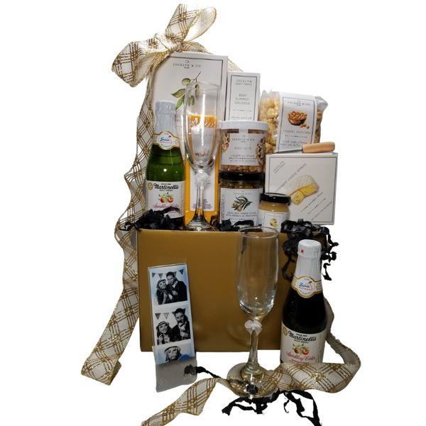 """Wedding Greetings Gift Basket Box: Send them off with a gift of treats from the Cornucopia's Epicure Shop, with an array of Cheeses, Hardwood Smoked Summer Sausage, Gourmet Crackers, Mixed Nuts, Vanilla Caramel popcorn, and much more in this party for two celebration box. * Gourmet Food products are made in the USA and are shelf stable.  Includes:  Reusable gift box Gold, Photo Booth Frame, 2 x 6 acrylic, 2- Champagne Flutes 2- 8.4 oz Martinelli's Sparkling Apple Juice, Mini Cheese Spreader, *5 oz jar Sevillano Green Olives with Herbes de Provence (basil, thyme, fennel, and lavender) *3.75 oz Camembert Cheese Spread 4""""H x 4""""Wx x1""""D *2 oz Gourmet Amber Beer Mustard, *5 oz Hardwood Smoked Summer Sausage, *8 oz Cheddar Cheese bar 7"""" tall x ¾ """"thick,  4.75 oz Mixed Nuts, delightful mix of crunch,  4 oz bagged Vanilla Caramel Popcorn 9"""" tall x 2.5"""" D, *4 oz Olive Oil & Sea Salt Crackers, GMO free boxed 7"""" Hx5"""" Wx2.125D,  Gift comes wrapped in cellophane with Gold and White Glitter hand tied bow, a complimentary enclosure card with your personal message."""