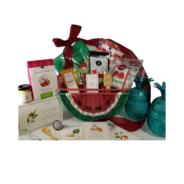 """Watermelon Tabletop Organizer Gift Basket: We found the cutest picnic tabletop organizer by C & C California Home outdoor entertaining ware. This watermelon utensil and plate holder comes pre-stocked with picnic fare and gourmet treats from the Cornucopia Epicure Shop. Other whimsies include 2-Pineapple shaped tumblers with straw, Grab food or basket liner/wraps, watermelon paper napkins, birch picnic forks with red sparkle handle, green paper plate and wood condiment spoon, watermelon mint tea Iceable blend, by the Cornucopia Tea Shop, infuser.  *Gourmet Food products are made in the USA and are shelf stable.  Includes:  Watermelon Tabletop Organizer by C & C California Home, outdoor entertaining, 2 Blue Pineapple Tumblers with Straw, Mini Wood Condiment Spoon, Mini Whisk, & three 1 oz Gourmet Dip Mixes, Garlic & Cheese, Rustic Vegetable, Parmesan & Artichoke All American Grub Wrap Papers, by Eat Drink Host, grease proof paper basket liner, food wrap. 12 ct. food safe. Watermelon Print luncheon Napkins 20 ct. Large Café Plates 8 ct. Eat Drink Host - Red Sparkle Birch Forks 12 pcs Tea Ball Infuser 1"""" stainless steel by Cha Cult 1 oz Fruit Tea Blend, flavored Watermelon/Mint by the Cornucopia Tea Shop A much loved summer combo: refreshing and wonderfully cooling, with a generous helping of melon cubes and flakes. A real pleasure served cold. Ingredients: apple pieces, Honeydew melon (melon, sugar, fructose-syrup), hibiscus blossoms, elderberries, peppermint (9%), flavoring, rose hip peel, watermelon flakes. *4 oz Forbes Old Fashion Saltwater Watermelon Taffy *2 oz Gourmet Amber Beer Mustard, *5 oz Hardwood Smoked Summer Sausage, *8 oz Cheddar Cheese bar 7"""" tall x ¾ """"thick, *4 oz Olive Oil & Sea Salt Crackers, GMO free boxed 7"""" Hx5"""" Wx2.125D  Gift comes wrapped in cellophane with a hand tied bow and a complimentary enclosure card with your personal message."""