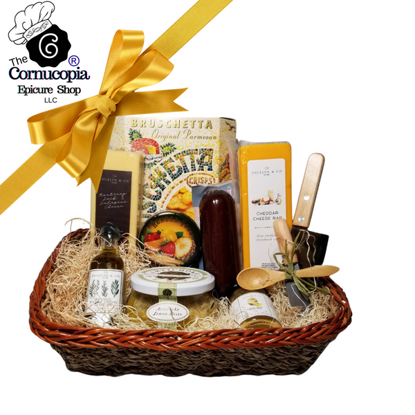 """Bruschetta Sampler Gourmet Gift Basket: From Cornucopia's Epicure Shop, a showcase of gourmet specialties and gifts. Starting with the reusable Seagrass Basket, Cleaver, Mini Cheese Spreader, Wood Antipasto Spoon, to the assortment of Shelf-stable, Cheeses, Summer Sausage, Amber Ale Mustard, Tuscan Extra Virgin Olive Oil, infused with rosemary, oregano, and basil (by Jocelyn & Co), Sour Dough Bruschetta Crisp, Bella Cucina Artichoke Parmesan Bruschetta Spread, and Rendezvous Tin of assorted fruit flavored hard candy. simply delicious gift.   Gifting Ideas: for a new home for friends, family, coworker, or employee. Great Realtors appreciation gift.  Includes:  Seagrass Basket Tray Stainless Steel Cleaver, Mini Cheese Spreader, Wood Antipasto Spoon 5 oz Rendezvous Tin of assorted fruit hard candy drops 3 oz. - Bruschetta Crisps Parmesan sourdough, 8""""H x 6.5""""W x 1.75""""D, a gourmet tradition for dips, cheese spreads, Olive Oil, Tomato Pesto spreads. 6 oz jar Bella Cucina Gourmet Pesto, Artichoke Lemon, *2 oz Gourmet Amber Beer Mustard, *5 oz Hardwood Smoked Summer Sausage, *8 oz Cheddar Cheese bar 7"""" tall x ¾ """"thick *8 oz Jalapeno Monterey Jack Cheese bar 7"""" tall x ¾ """"thick, *60 ml Tuscan Extra Virgin Olive Oil, infused with rosemary, oregano, and basil. A perfect accompaniment for a cheese board,  *Gourmet Food products are made in the USA and are shelf stable.  Gift comes wrapped in cellophane with Matching Ribbon & Shred Fill, a complimentary enclosure card with your personal message."""