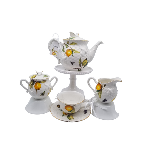 Crafted Gold Bee Lemon - 5pc Tea Set: by Grace Teaware. fine porcelain, raised print of bee and lemon on white fine porcelain, gold trim. 1 Teapot, 1 Set of Sugar & Creamer, and 2 Sets of Cup & Saucer. A little sunshine for your luncheon or breakfast table. Lovely for a ladies luncheon.  Gifting Idea: Birthday, Bridal Shower, or Mother's Day. treat yourself or someone you love!  Includes:  5 pc porcelain tea set 1- 3 cup Capacity 2 - cup/saucer set 1- cream/sugar set Dishwasher safe  Complimentary Enclosure Card