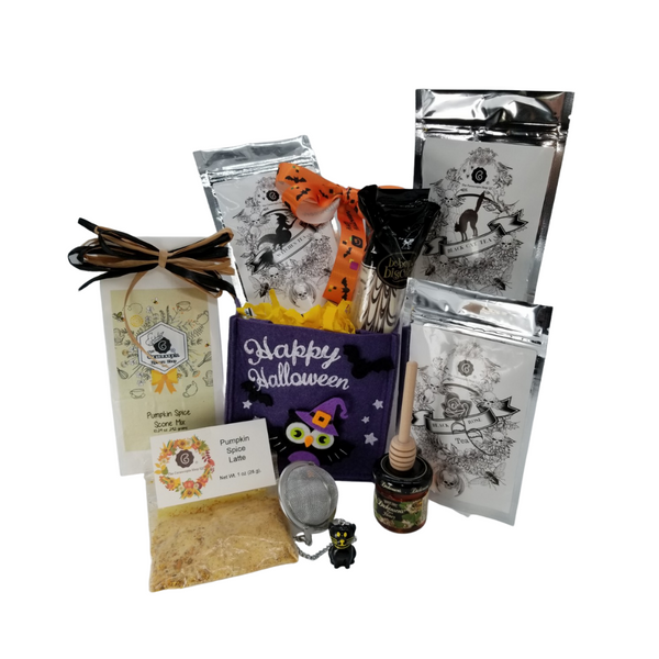 """You've Been Booed - Mini Gourmet Gift Basket: This pumpkin treat bag comes with three Cornucopia's Halloween Teas pulled from the crypt and waiting to be brewed in the black cat tea ball. So frightfully delicious with the Hazelnut Biscotti, Pumpkin Spice infused Sugar, and our very own Pumpkin Spice Scone mix. Hauntingly delightful, you'll want one too.  Gift Includes:  Owl Happy Halloween Felt Gift Bag 4.9 x 5.1"""" Cornucopia's Pumpkin Spice Scone Mix makes 8 scones, 3-Cornucopia brand Specialty Halloween Teas: 1 oz Black Cat Fruit tea blend, flavored Chocolate/Peanut/Caramel. Sweet chocolate aromas, combined with delicately melting caramel and the taste of crunchy peanuts will put a smile on any sweet tooth! 1 oz Black Witch's Brew, a mild China-Ceylon black tea blend, will remind you just how Witchfully delightful it can be with light-yellow orange peel and orange-red blazing safflower. 1 oz Black Rose Tea combines our full-bodied organic black tea with fragrant rose petals. 2"""" Halloween Black Cat Tea ball stainless steel Tea filter by Cha Cult (Germany) 1 oz Cornucopia's Pumpkin Spice Infused Sugar, 2 Be-Bop Hazelnut Zebra Biscotti Dickinson's Mini Honey 1 oz, Honey Spool wooden,  *Gourmet Food products are made in the USA and are shelf stable.  Gift comes wrapped in cellophane with hand tied bow, a complimentary enclosure card with your personal message"""