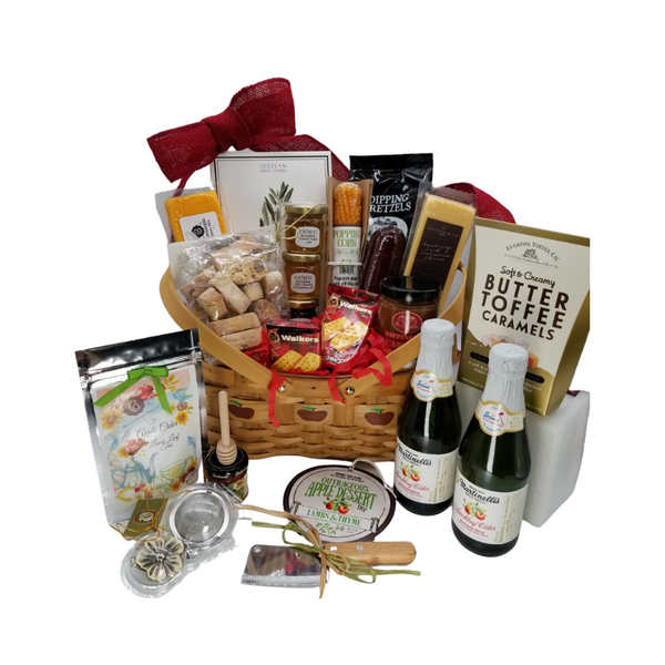 """Apple Harvest Gourmet Gift Basket: From Cornucopia's Epicure Shop, a showcase of apple harvest favorites of gourmet specialties brimming in fall flavors of crisp apples, apple dessert dip, caramel dip, dipping pretzels, toffee candy, and an array of shelf-stable, Cheeses, Summer Sausage, Gourmet Crackers (by Jocelyn & Co) & Apple Cider Loose Leaf Tea (The Cornucopia Shop) tea condiments and accessories. all tucked inside this beautiful apple print wood basket with drop down handles that doubles as a keepsake for years of home décor enjoyment.  Great Gifting Ideas: Fall Birthday, New Home, Welcome Home, Appreciation, Happy Fall, Happy Thanksgiving   Gift Includes:  11"""" Apple print wood chip basket with drop handles 4 oz Olive and Sea Salt Gourmet Cracker by Jocelyn & Co Stainless Steel Cleaver, 2 oz East Shore Dipping Pretzel East Shore Caramel Dipping Sauce *5 oz Hardwood Smoked Summer Sausage, *8 oz Cheddar Cheese bar 7"""" tall x ¾ """"thick, *8 oz Jalapeno Monterey Jack Cheese bar 7"""" tall x ¾ """"thick, Cheese Plate Jelly Trio, 2 oz jars of confetti pepper jelly, garlic rosemary & chardonnay jelly, tomato ginger jam. 2 Be-Bop Hazelnut Zebra Biscotti, 2 oz. - Everton Butter Toffee Caramels, 2- 8.4 oz Martinelli's Sparkling Apple Juice Outrageous Apple Dip by Lambs & Thyme, our favorite gourmet spice company! 4 oz Walker's Fingers Shortbread Cookie -2 pack 1 oz. Autumn Apple Cider Fruit Tea (Loose Leaf) by the Cornucopia Shop Teas, Ingredients: apple pieces, cinnamon rods, hibiscus blossoms, apple slices, sliced almonds, rose hip peel, elderberries, currants, whole star aniseed, natural flavoring, cinnamon pieces. 2"""" Tea Ball with fall flower charm, stainless steel Dickinson's Mini Honey 1 oz. Honey Spool wooden  *Gourmet Food products are made in the USA and are shelf stable.  Gift comes wrapped in cellophane with hand tied plaid bow, a complimentary enclosure card with your personal message"""