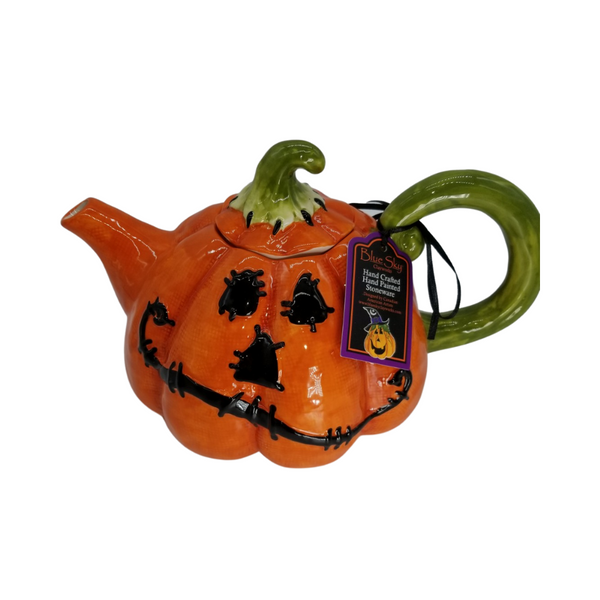 Jack O' Lantern Teapot: Enjoy this Halloween Jack O' Lantern Teapot, it holds 4 cups, hand crafted, hand painted stoneware by Blue Sky Clayworks! Fun and food safe, or pretty addition to your Holloween Table Top decor. Designed by Canadian/American Artists. He has the cutiest face, with a charming grin, his handle is a pumpkin vine.  Gift enclosure card comes with a 10% off coupon for first time tea purchase for your recipient and your personal message. This enclosure cardis tucked inside the gift