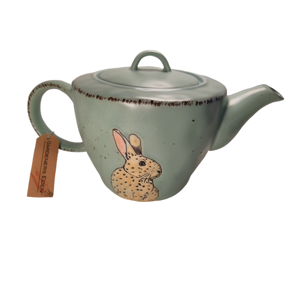 Earthen Bunny Teapot with optional Tea Gift. Glazed Earthenware 32 oz Bunny on both sides brown accents on dusty robin egg blue background. Dishwasher and microwave safe. Enjoy Cornucopia's Organic Loose Leaf Tea in this bright and cheery tea pot. Give as a gift or splurge on yourself.
