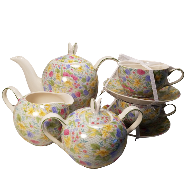 Bunny Spring Tea Set with Optional Tea Gift:This delightful porcelain spring floral print tea set is topped with delicate bunny ear handles on the teapot and sugar bowl.  Set contains: 4 cup teapot, 2 matching cups and saucers, matching creamer and sugar bowl.  Will bring a little cheer to your everyday table.    Porcelain Dishwasher and microwave safe.  Enjoy 2 oz. of Cornucopia Shop's Organic Loose Leaf Tea in this bright and cheery teapot.  Tea choices available with orders, decorative tea packaging. Ships together.