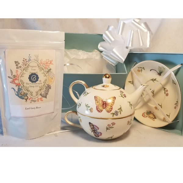 """Morning Meadows Teapot Duo is a nested Teapot, cup and Saucer set comes in a beautiful pastel blue satin lined gift box. A lovely way to great the day with a moring cup of tea! This nested set allows a second cup ready to serve. A Bloggers favorite! This special gift comes with 2 oz of Cornucopia's Earl Grey Rose Organic Loose Leaf Tea.  Tea Notes:  Earl Grey Rose (Loose Leaf) combines our full-bodied organic black tea with fragrant rose petals. Ingredients: Organic black tea, organic rose petals and natural flavor. Taste: Earl Grey Rose is a full-bodied black tea brew with a floral finish. Origin: Sourced from family tea gardens in the Darjeeling and Assam regions of India.  Includes:  Morning Meadows Teapot Duo, nested all in one Teapot, Teacup and Saucer with satin lined Gift Box, 2 oz of Earl Grey Rose Cornucopia's Organic Loose Leaf Tea  Completed gift measures 6"""" long by 6"""" wide and 6"""" tall and weighs 2 pounds.   This gift comes in a pastel blue satin lined box with a white bow."""