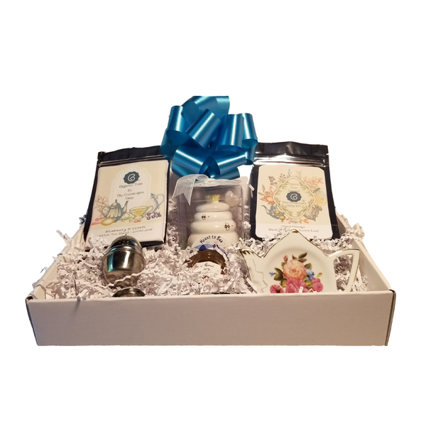 """Cornucopia Tea Essential Set-Gift Box, A great gift for a tea lover or as an introduction to tea. They'll love the two tea loose leaf samples, honey pot, honey, T-ball infuser, measuring spoon and   Tea Notes:  Blueberry Violet: Apple pieces, mountain blueberry leaves, mountain blackberry leaves, rose hip peel, orange peel, blackberry leaves, sweet blackberry leaves, melissa leaves, lemon grass, lemon peel, natural flavoring, mallow blossoms, blue butterfly pea flowers, blue cornflower blossoms. Blood Organge: Black tea (92 %), orange peel, natural blood orange flavoring, safflower  Important: Always brew with boiling water and let infuse for 5-10 minutes in order to obtain a safe beverage!  Includes:  1oz Herbal blueberry violet Loose Leaf Tea, 1oz Black Tea blood orange Loose Leaf Tea, 1- Honey Pot with Honey spool 1 oz Bonne Maman honey, 1- loose leaf measuring spoon with engraved wording on the handle """" A cup of perfect tea"""", small T-ball infuser, 1-Bone China Tea Bag Holder, Teapot shaped with a floral pattern and gold trim.  Gift measures 9"""" long by 12"""" wide and 3"""" tall and weighs 2 pounds. Comes shrink wrapped with a teal bow."""