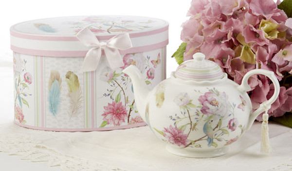 """Feather and Floral Teapot in gift box, will brighten anyone's day with this beautiful Teapot gift in its own matching print gift box and matching satin ribbon. A decorative tassel on the handle adds a lovely finishing touch. Gifting Ideas: birthday gift, bridal shower, get well, treat yourself or someone you love.  Includes: • 9.5 x 5.6"""" Porcelain teapot • Soft white background with a feather and floral print in bright cheery pastels, Dishwasher safe  •Matching cup and saucer available D8135-6 •Tea choices available to add to your order in the loose-leaf shop   Teas and Teaware are shipped together, Cornucopia Teas come in resealable pouches with decorative tea labels, and includes a recipe and brewing guide. If purchasing as a gift your personal message is included on the pamphlet."""