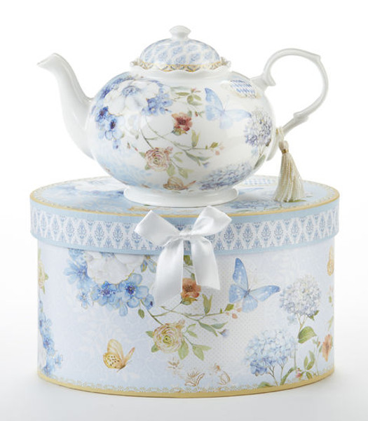 """Blue Butterfly Teapot in gift box, will brighten anyone's day with this beautiful teapot gift in its own matching print gift box with matching satin ribbon. A decorative tassel on the handle adds a lovely finishing touch. Gifting Idea: birthday gift, bridal shower, get well, treat yourself or someone you love.  Includes:  9.5 x 5.6"""" teapot Soft white background with a Blue Butterfly and pastel floral print Dishwasher safe  Other Items Available:  Matching cup and saucer available D8151-4  Tea choices available to add to your order in the loose-leaf shop  Teas and Teaware are shipped together, Cornucopia Teas come in resealable pouches with decorative tea labels, and includes a recipe and brewing guide. If purchasing as a gift your personal message is included on the pamphlet."""