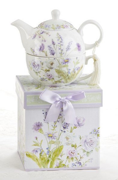 """Lavender Rose Tea for one set in gift box, will brighten anyone's day with this beautiful tea for one gift set in its own matching print gift box with matching satin ribbon. A decorative tassel on the handle adds a lovely finishing touch. Gifting Idea: birthday gift, bridal shower, get well, thank you or treat yourself. Holds enough for a refill without leaving your comfy spot, desk or sip at beside for an evening nightcap.  Includes:  5.8"""" Tea for One Set in gift box Stacked teapot and oversized teacup Soft white background with a lavender and roses floral print Dishwasher safe  Other Items Available:  Tea choices available to add to your order in the loose-leaf shop  Teas and Teaware are shipped together, Cornucopia Teas come in resealable pouches with decorative tea labels, and includes a recipe and brewing guide. If purchasing as a gift your personal message is included on the pamphlet."""