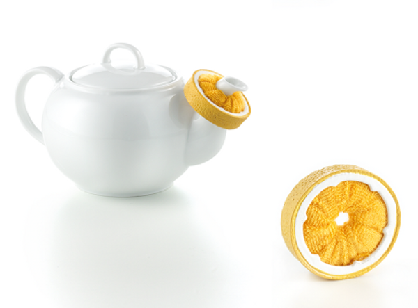 Drop Catcher - Lemon Slice  Slip it over any size teapot spout to catch those little anoying spills.  Quick clean by rinsing out under the kitchen faucet. Great Stocking Stuffer!