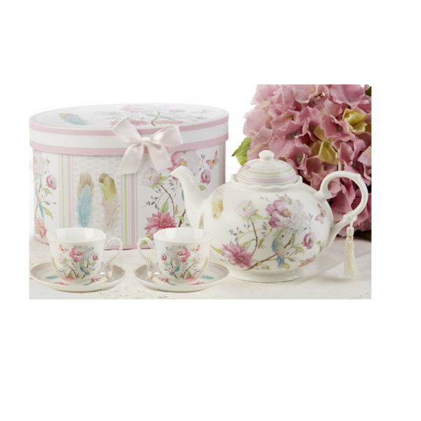 """Feather and Floral Tea Set, will brighten anyone's day with this beautiful tea set in its own matching print gift box and matching satin ribbon. A decorative tassel on the handle adds a lovely finishing touch. Gifting Ideas: birthday gift, bridal shower, get well, treat yourself or someone you love.  Includes:  9.5 x 5.6"""" Porcelain teapot, holds 4 cups (32 oz) 2 cup/saucer Soft white background with a feather and floral print in bright cheery pastels, Dishwasher safe  Other Items Available:  Add additional sets of matching cup and saucer D8135-6 Tea choices available to add to your order in the loose-leaf shop Teas and Teaware are shipped together, Cornucopia Teas come in resealable pouches with decorative tea labels, and includes a recipe and brewing guide. If purchasing as a gift your personal message is included on the pamphlet."""