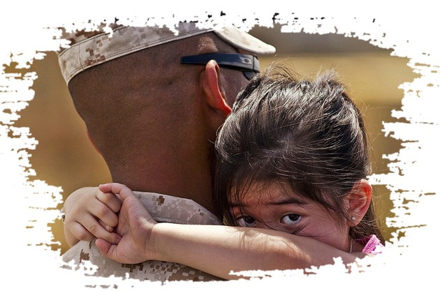 Military Child Hugging Her Uniformed Father And Looking At The Camera