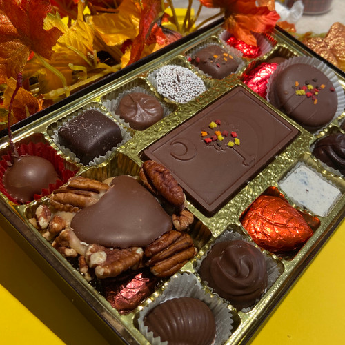 A fall assortment of hand dipped chocolates in white, milk and dark chocolate