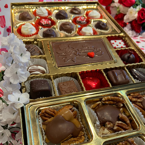1.5 lbs of chocolate bliss-a variety of our homemade chocolates that include red velvet truffles , sea salt caramels, pecan fiddlers, and a Valentines greeting card