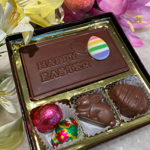 3 pieces of delicious chocolates surrounding a chocolate Easter card