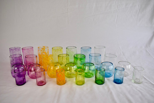 Selection of handcrafted drinking glasses made from recycled glass From left to right: Violet, Fuchsia, Saffron, Lemon Yellow, Bristol Green, Turquoise, Clear