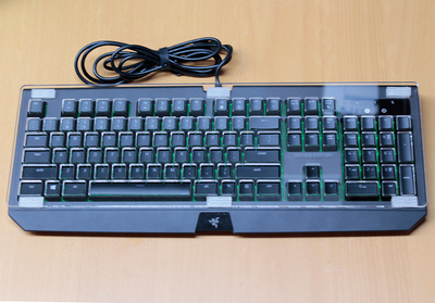 Keyguard mounted with DualLock reclosable fasteners on BlackWidow keyboard.