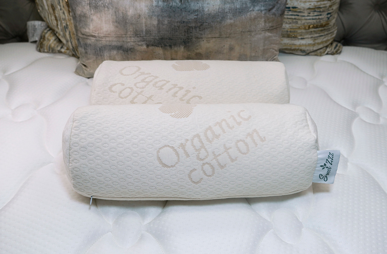Two Sweet Zzz Buckwheat pillows shown on a bed in cylinder size