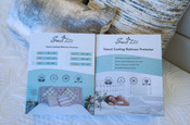Sweet Zzz cooling mattress protector on bed with both front and back cover shown