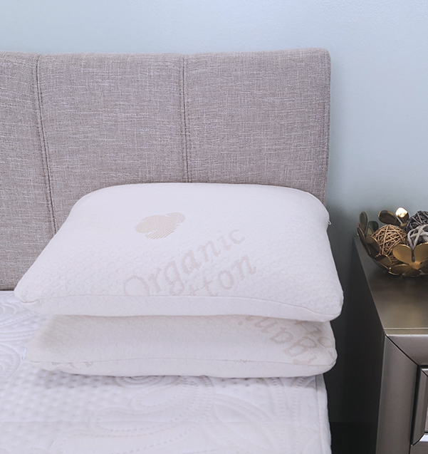 Two Sweet Zzz buckwheat pillows on a bed on top of each other